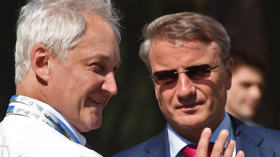 Помощник президента России Андрей Белоусов и президент Сбербанка России Герман Греф