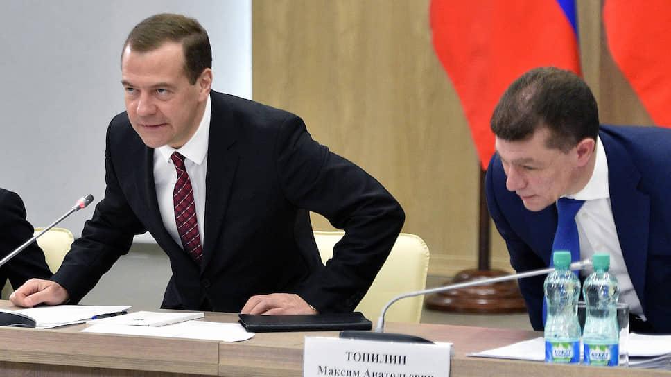 Председатель правительства России дмитрий Медведев и министр труда и социальной защиты России Максим Топилин