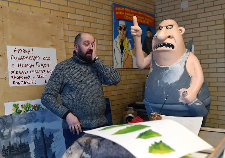 Художник Алексей Куделин (слева) проявил сдержанный интерес к экологической политике