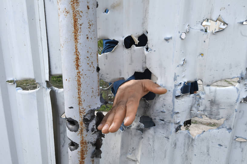 Последствия обстрелов в городе Барда