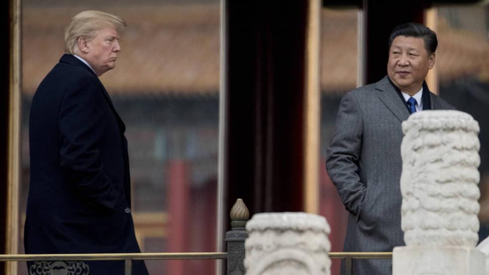 Президент США Дональд Трамп и его соратники уверены, что возвращение к старой модели отношений Вашингтона с Пекином (справа — председатель КНР Си Цзиньпин) уже невозможно