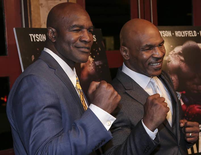 Последний бой между Эвандером Холифилдом (слева) и Майком Тайсоном прошел 24 года назад и закончился тем, что Тайсон откусил у Холифилда кусочек уха