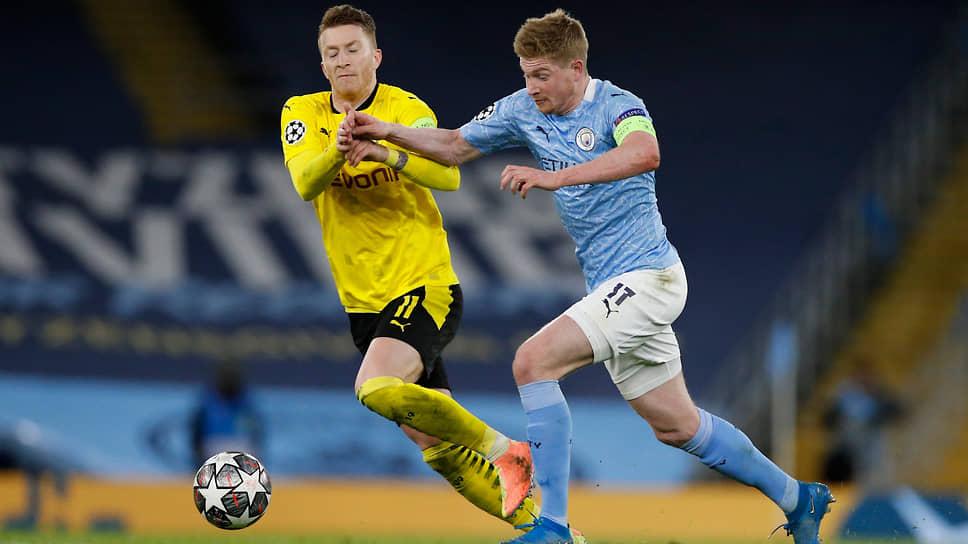 Игрок «Манчестер Сити» Кевин Де Брёйне (справа) и игрок дортмундской «Боруссии» Марко Реус