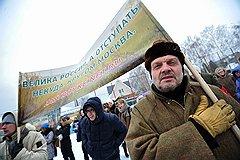 Музыкальный критик Александр Липницкий готов с плакатом в руках защищать родную Рублевку от московских чиновников