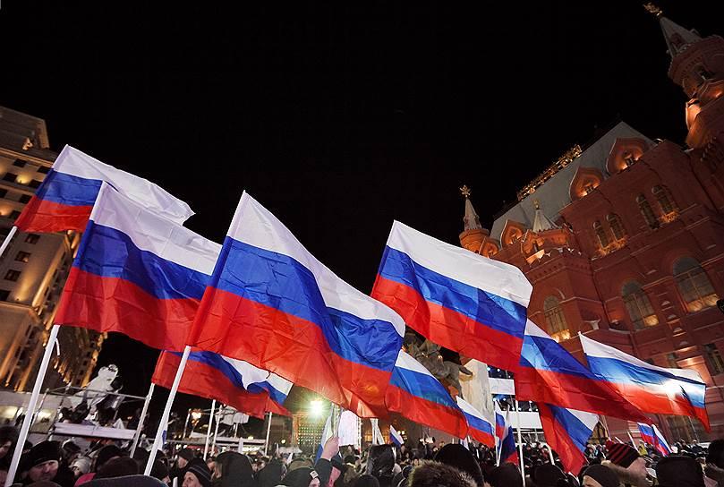 Митинг-концерт «Россия. Севастополь. Крым», посвященный четвертой годовщине присоединения Крыма к России, на Манежной площади