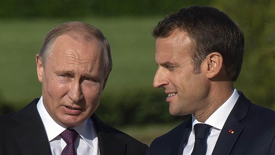 Президенты России и Франции Владимир Путин и Эмманюэль Макрон
