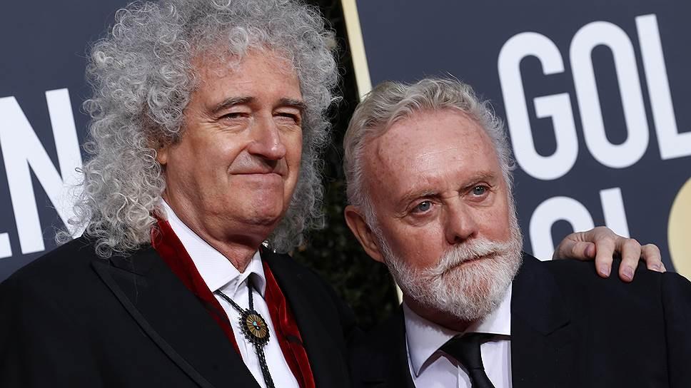 Участники группы Queen Брайан Мэй (слева) и Роджер Тейлор