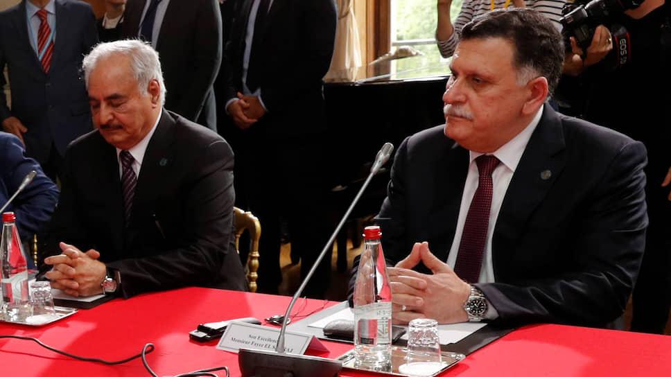 Глава Ливийской национальной армии фельдмаршал Халифа Хафтара и глава Правительства национального согласия Ливии Файез Саррадж