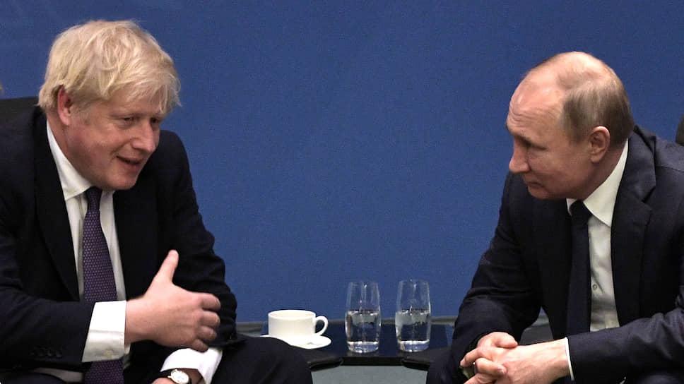 Премьер-министр Великобритании Борис Джонсон (слева) и президент России Владимир Путин