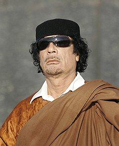 Годы и власть сильно изменили диктатора, рожденного в бедуинском шатре. На фото — три года назад