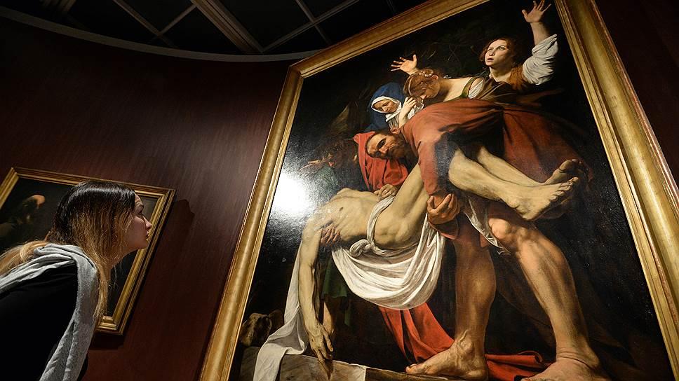 «Положение во гроб» Караваджо на выставке шедевров из Ватиканской пинакотеки в Третьяковке в 2016-м. Эта экспозиция стала одним из ярких примеров того, насколько продвинулись отношения Москвы и Ватикана при нынешних лидерах