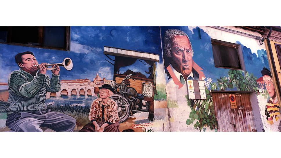 Граффити с изображением Феллини в Италии повсюду