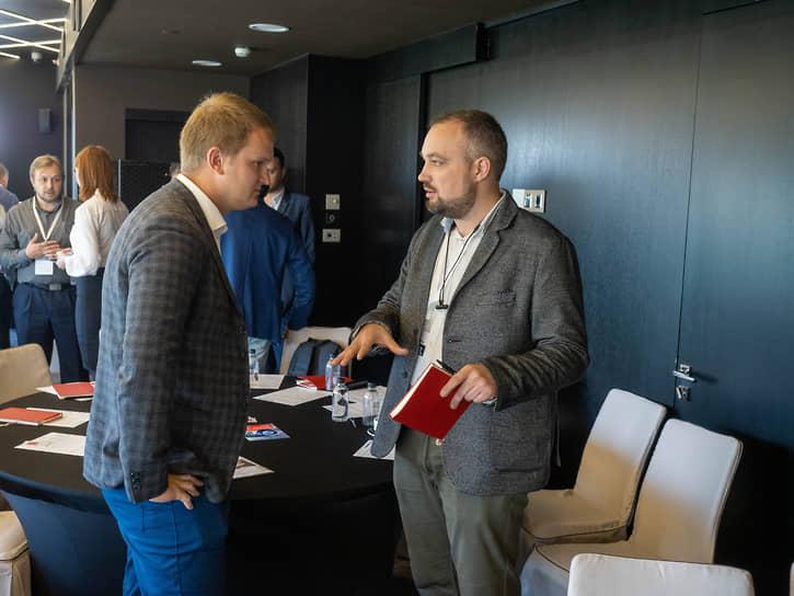 Руководитель проектного отдела «ИТ-Град» и #CloudMTS Евгений Свидерский (слева)