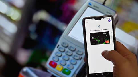 Телефон как средство платежа  / Покупатели переходят с пластиковых карт на цифровые