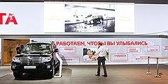 """На стенде """"Тойоты"""" была выделена отдельная зона послепродажного обслуживания, на элементах которой были представлены логотип бренда и три пиктограммы ценностей """"Официального сервиса Toyota"""""""