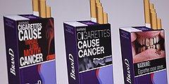 В США, где развязалась антитабачная война, власти навязывают производителям сигарет все более устрашающий дизайн пачек