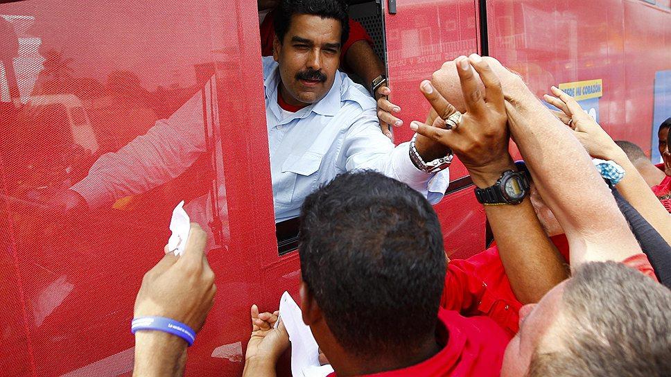 И Николас Мадуро (на фото), и Энрике Каприлес в ходе предвыборной кампании старались заручиться поддержкой беднейших слоев населения