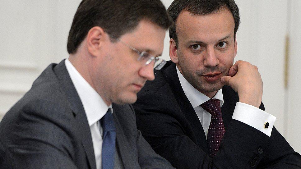 Российское правительство еще не определилось, как отреагировать на предложение США начать переговоры о будущем газового рынка Азии (на фото слева — Александр Новак, справа — Аркадий Дворкович)