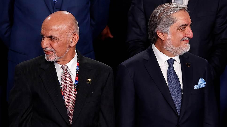 Президент Афганистана Ашраф Гани (слева) и премьер-министр Абдулла Абдулла расходятся во взглядах на реформу избирательной системы страны