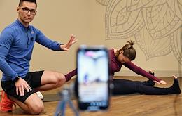 Coach conducts an online training session at one of the World Class clubs in Moscow. Pilates Mat with Marat Kalmurzaev (Mind Body Studio).