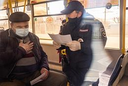 Kazan during self-isolation regime caused by the danger of the coronavirus COVID-19 spread. Genre photography. Police officers conduct a surprise checking of public transport to identify self-isolation violators.