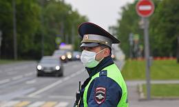 Self-isolation regime caused by the danger of the coronavirus COVID-19 spread. Genre photography. Road police service officers patrol the city and check motorcyclists' IDs.