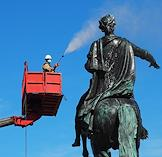 Employees of the Museum of Urban Sculpture conduct routine washing of the The Bronze Horseman, a monument to Peter The Great erected in honor of the founding of St. Petersburg.