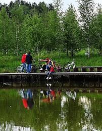 Moscow Region during self-isolation regime caused by the danger of the coronavirus COVID-19 spread. Genre photography. People having a walk in Meshchersky Park.