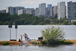 Moscow during self-isolation regime caused by the danger of the coronavirus COVID-19 spread. People went for a walk to the parks of the Schukino district, Stroginskaya floodplain (Big Stroginsky backwater).