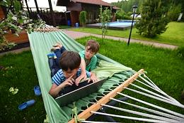 Self-isolation regime caused by the danger of the coronavirus COVID-19 spread. Children at the summer house. Malyshevo village, Ramensky urban district, Moscow region, Russia.
