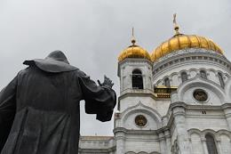 Moscow during self-isolation regime caused by the danger of the coronavirus COVID-19 spread. Genre photography. Cathedral of Christ the Savior reopened to parishioners. Liturgy in the Transfiguration Church of the Cathedral of Christ the Savior.