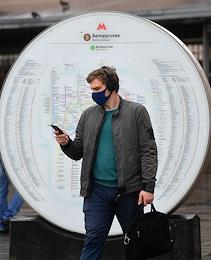 Moscow during self-isolation regime caused by the danger of the coronavirus COVID-19 spread. The beginning of the second stage of removing coronavirus restrictions. Genre photo. Passers-by.