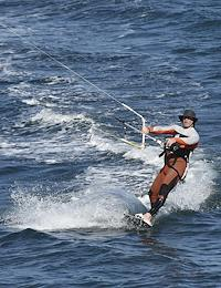 Crimea after self-isolation regime caused by the danger of the coronavirus COVID-19 spread was cancelled. Residents of Crimea do kitesurfing on the Black Sea.