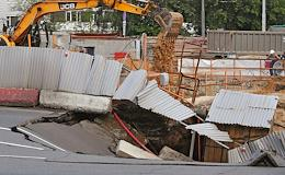 Sinkhole at the construction site adjacent to the road on Marshal Zhukov Prospect.