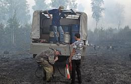 Forest fires in the Omsk Region. Specially trained team of forestry workers of Bolshie Uki village extinguish fires.