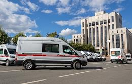 Hand-over of new ambulances to medical workers.