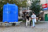 Genre photographs about the shortage of drinking water in Crimea. The republic has an hourly schedule of water supply. In the city, 5 cubic storage tanks with drinking water are installed near the houses. The shallow Partizanskoe and Simferopol reservoirs.
