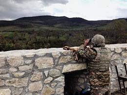 An Armenian soldier examines the Azerbaijani positions, a shell at the Amaras monastery, Amaras monastery on the border of NKR and Azerbaijan