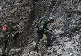 Mountain Eventing Championship. 10 teams from the divisions of Yuzhny military district. Mountain triathlon is rock climbing, mountain strip obstacles and a 5 km march on rough terrain with shooting from Kalashnikov assault rifle.