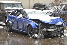 The wrecked car of blogger Edvard Bil at the special parking in the Central Administrative District.