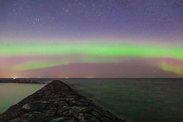 Northern lights in the Dalekaya Bay on the shores of Lake Ladoga.