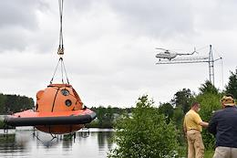 Training of the ISS-69 crew on actions after landing of the descent vehicle on the water surface at the base of the Noginsk Rescue Center of the EMERCOM of Russia and with the assistance of employees of the Ministry of Emergency Situations.
