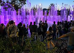 Views of evening Kaliningrad. Light and music fountain in the park of the 70th anniversary of the Kaliningrad region and the Pregolya river.