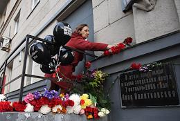 15 years since the murder of journalist Anna Politkovskaya. Action in memory of journalist Anna Politkovskaya near the house where she lived and was killed and the building of the editorial office of 'Novaya Gazeta'. Laying flowers at the memorial plaque.