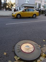 Painter Slava PTRK installed shell-shaped hatches in memory of journalist Anna Politkovskaya, who was killed 15 years ago. Installation at the editorial office of Novaya Gazeta.