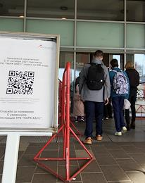 Checking QR codes from visitors of the Park House shopping center.